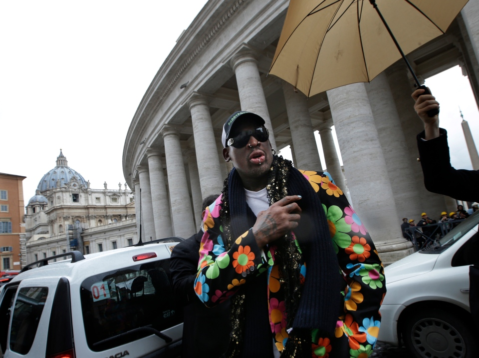 Former NBA star Dennis Rodman walks next to the Bernini Colonnade near St. Peter's Square at the Vatican, Wednesday, March 13, 2013. (AP Photo/Andrew Medichini)