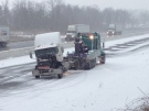 A damaged cab is towed away from the site of a crash on Highway 401 near Drumbo, Ont., on Wednesday, March 13, 2013. (Kevin Doerr / CTV Kitchener)