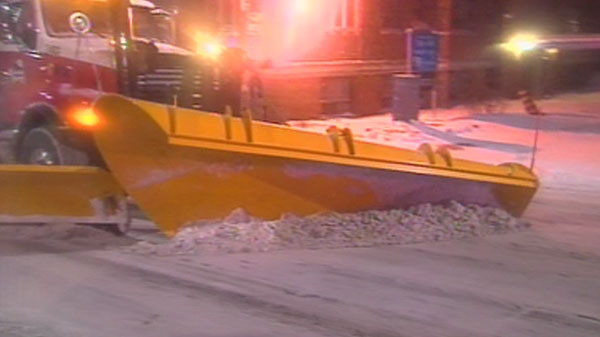 A snow plow clears a road after a storm blanketed Toronto with snow on Wednesday, Feb. 2, 2011.