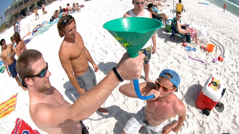 Students on spring break from the University of Tennessee funnel beers near the Whale's Tail Restaurant on Miramar Beach, Florida. (Northwest Florida Daily News, Nick Tomecek)