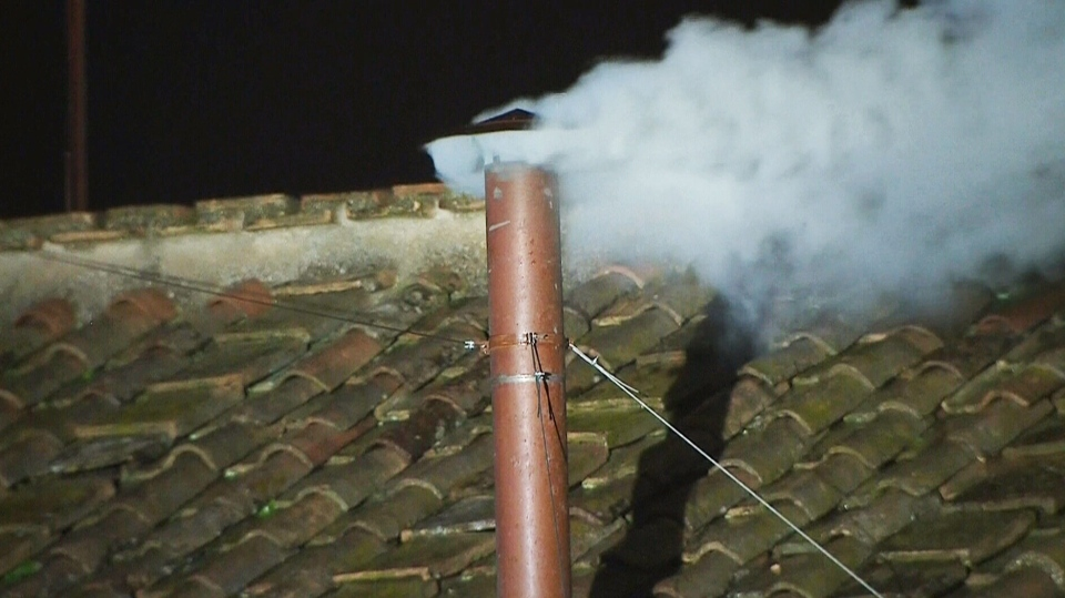 White smoke billows from the chimney of the Sistine Chapel, meaning Roman Catholic cardinals have elected a pope in their fifth round of balloting, at the Vatican, Wednesday, March 13, 2013.