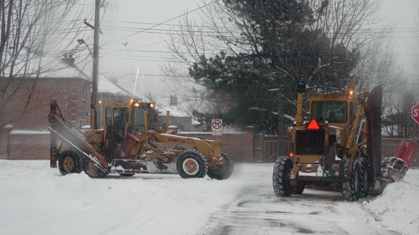 Snow plows clear a road after a storm blanketed the Greater Toronto Area with snow on Wednesday, Feb. 2, 2011. (David Bradley / MyNews.CTV.ca)