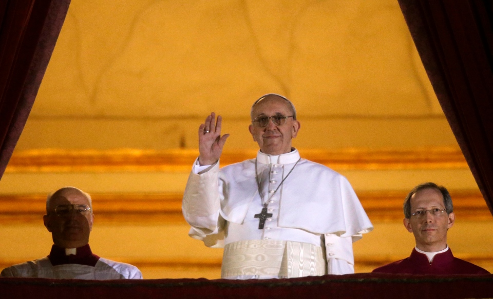 Pope Francis I waves to the crowd from the central balcony of St. Peter's Basilica at the Vatican, Wednesday, March 13, 2013. Cardinal Jorge Bergoglio who chose the name of Francis is the 266th pontiff of the Roman Catholic Church. (AP / Gregorio Borgia)