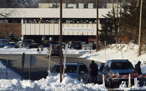 Police block the road at the entrance to the new Sandy Hook Elementary School on the first day of classes in Monroe, Conn., in this Jan. 3, 2013 file photo. (AP Photo/Jessica Hill)