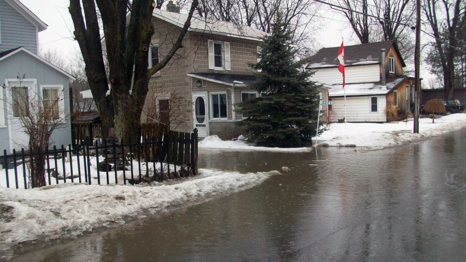 Water from the thaw and rain flooded Old George St. in Osgoode.