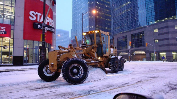 A snow plows makes its way through the downtown core of the Greater Toronto Area after a storm blanketed the region, Wednesday, Feb. 2, 2011. (David Bradley / MyNews.CTV.ca)