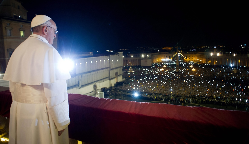Pope Francis looks at the crowd from the central balcony of St. Peter's Basilica at the Vatican, Wednesday, March 13, 2013. (L'Osservatore Romano)