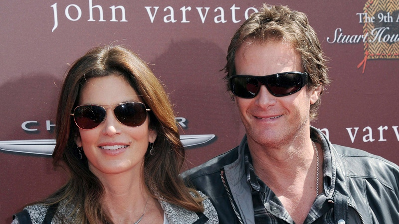Cindy Crawford, at left, and Rande Gerber arrive at The John Varvatos 9th Annual Stuart House Benefit, Sunday, March 11, 2012, at The John Varvatos boutique in Los Angeles.  (AP Photo / Katy Winn)