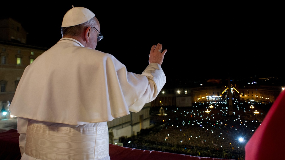 Pope Francis waves the crowd from the central balcony of St. Peter's Basilica at the Vatican, Wednesday, March 13, 2013. (L'Osservatore Romano)