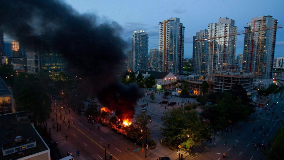Rioters burn police cars after the Vancouver Canucks were defeated by the Boston Bruins in the NHL's Stanley Cup Final in Vancouver, B.C., on Wednesday, June 15, 2011. (Darryl Dyck / THE CANADIAN PRESS)