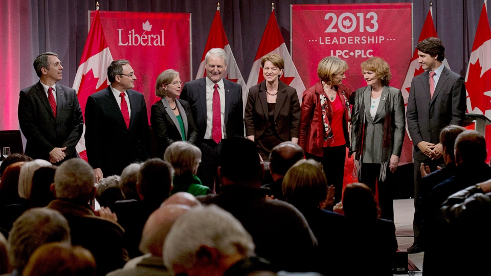 David Bertschi, Martin Cauchon, Deborah Coyne, Marc Garneau, Martha Hall Findlay, Joyce Murray, Karen McCrimmon and Justin Trudeau are applauded at the end of the Liberal party leadership debate in Halifax on Sunday, March 3, 2013. (Andrew Vaughan / THE CANADIAN PRESS)