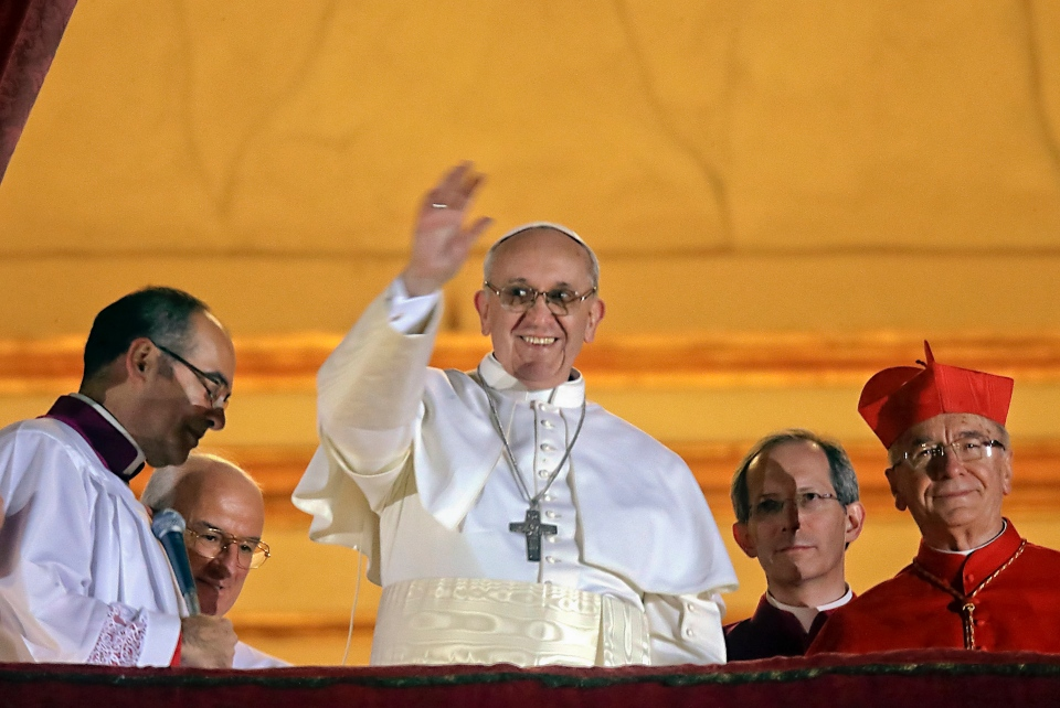Pope Francis waves to the crowd from the central balcony of St. Peter's Basilica at the Vatican, Wednesday, March 13, 2013.  (AP / Gregorio Borgia)