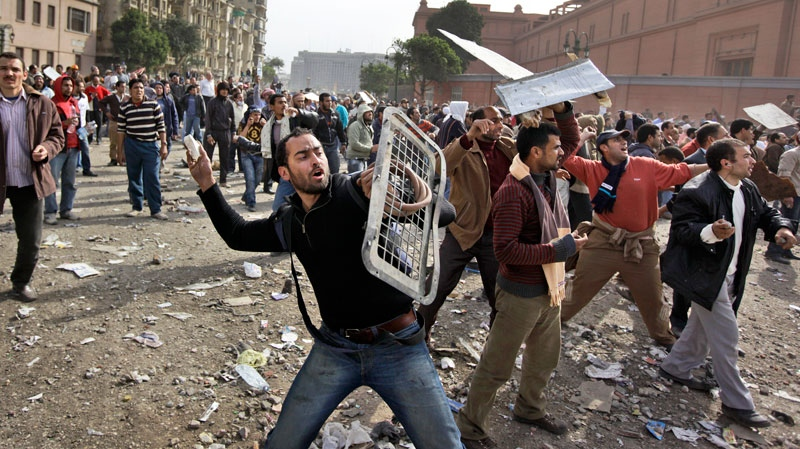 Anti-government protestors throw stones during clashes in Cairo, Egypt, Thursday, Feb. 3, 2011. (AP / Ben Curtis)