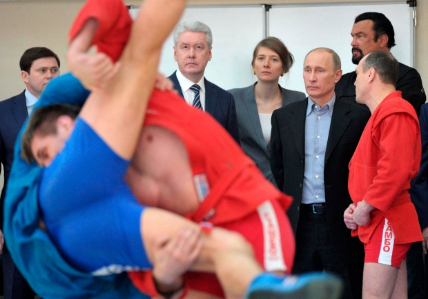 putin ahmaninedjad voice support for return of olympic wrestling russias putin supports cap on presidential terms 620x349