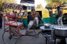 An Indian rickshaw driver speaks on his mobile phone in New Delhi, India on Feb. 28, 2013. (AP Photo/Tsering Topgyal)