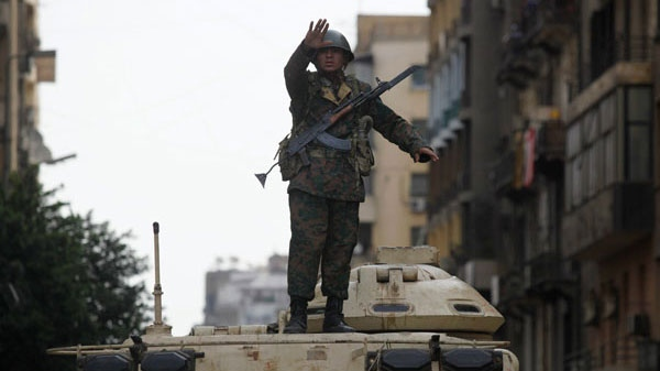 A soldier standing on a tank gestures in Cairo's Tahrir Square, Egypt, Thursday, Feb. 3, 2011. (AP / Victoria Hazou)