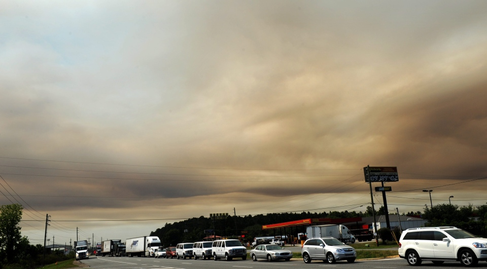 Cars line up on US-301 to go East on Interstate 10 as a smoky sky looms in Jacksonville, Fla., in this April 2012 file photo. (The Florida Times-Union/Bob Mack)