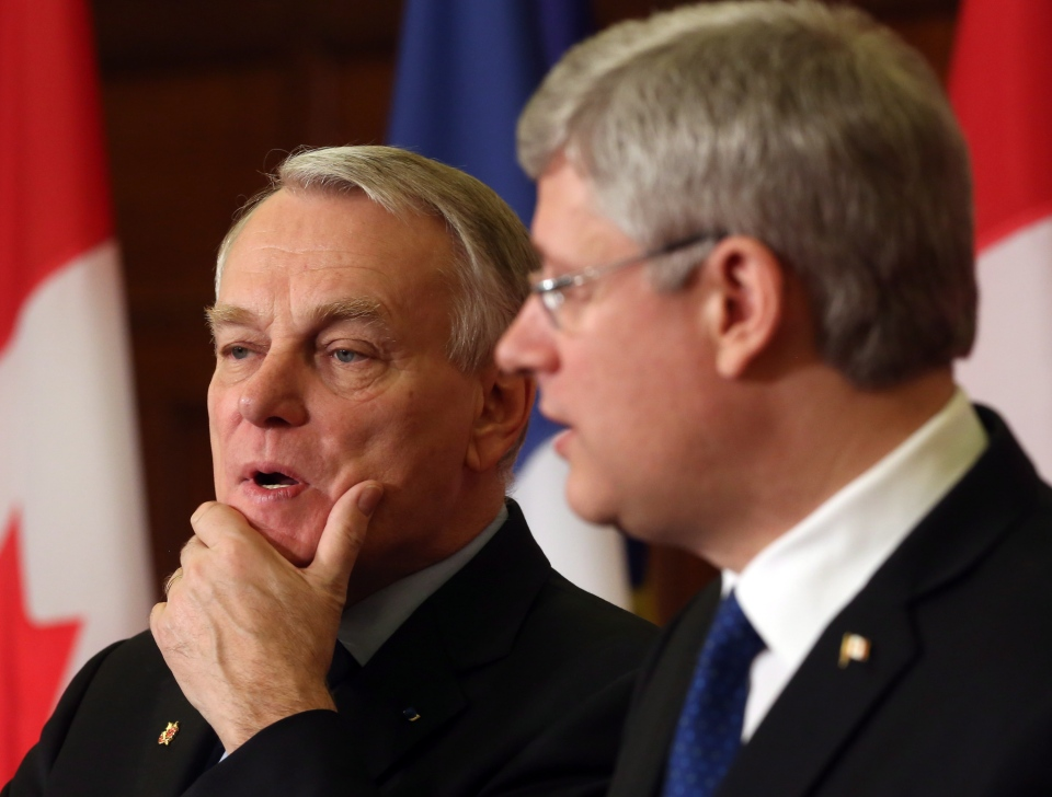 French Prime Minister Jean- Marc Ayrault and  Prime Minister Stephen Harper take part in a joint news conference on Parliament Hill in Ottawa Thursday, March 14, 2013. (Fred Chartrand / THE CANADIAN PRESS)