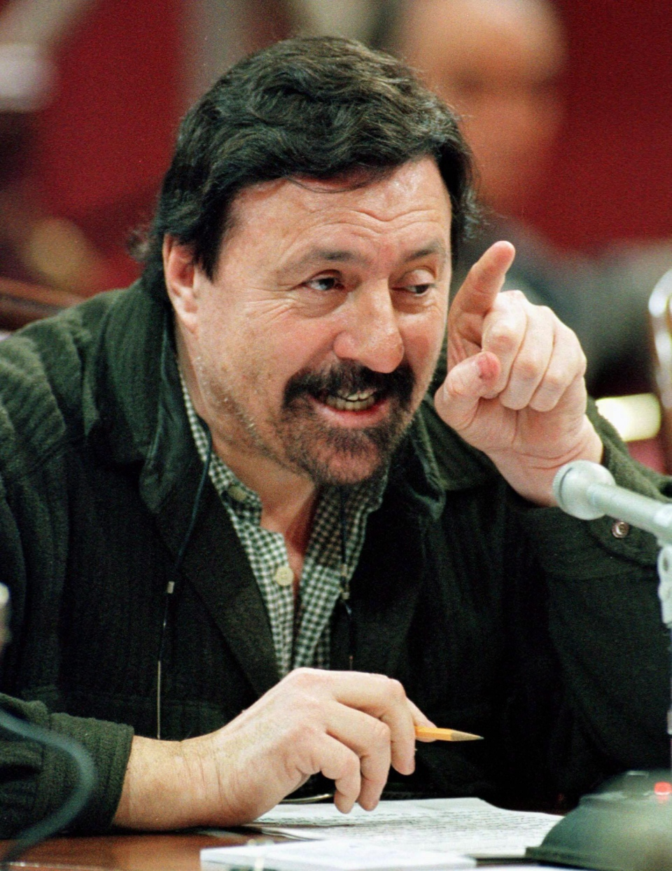 Former FLQ member Paul Rose gestures as he appears before a legislature committee in Quebec City in this March 2000 file photo. (Jacques Boissinot / THE CANADIAN PRESS)