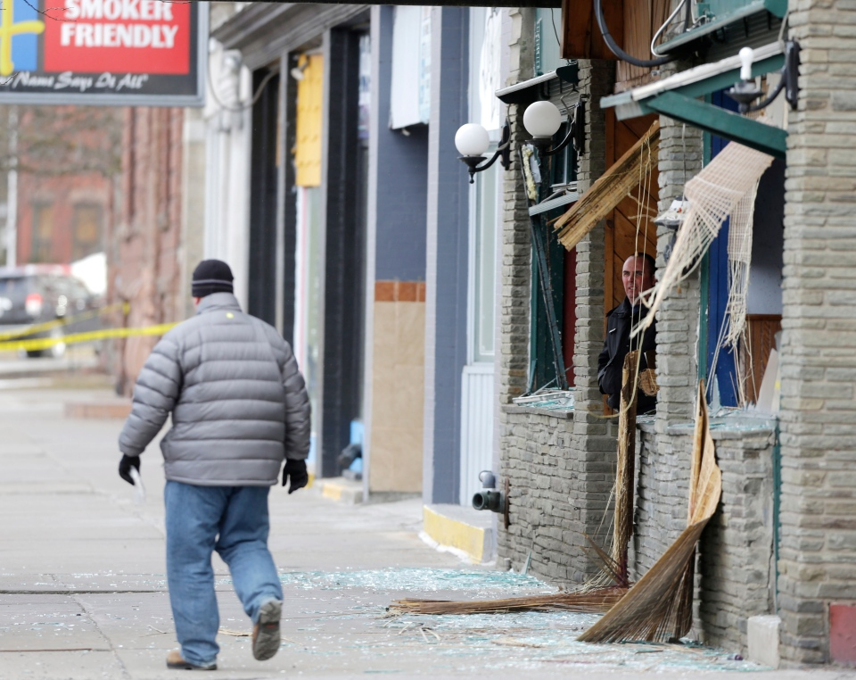 Law enforcement officials work at the building where a man was killed after police stormed it following a standoff in Herkimer, N.Y., Thursday, March 14, 2013. (AP / Mike Groll)