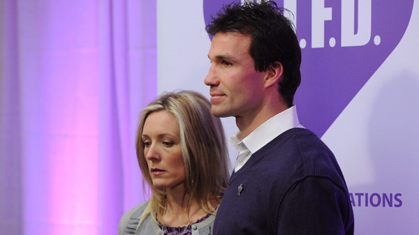 Ottawa Senators assistant coach Luke Richardson and his wife Stephanie arrive for an announcement on mental health in Ottawa, Wednesday, Feb. 2, 2011. The Richardson's daughter Daron committed suicide last year. THE CANADIAN PRESS/Adrian Wyld