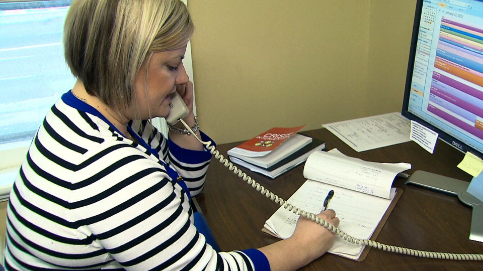 Crisis Response Worker Lisa Mendonca takes a call for the mental health program underway in London, Ont.
