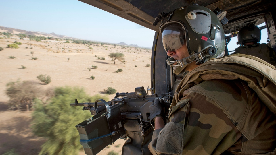 A French air force helicopter patrols over the Adrar region in northern Mali, March 8, 2013. (Arnaud Roine / ECPAD)