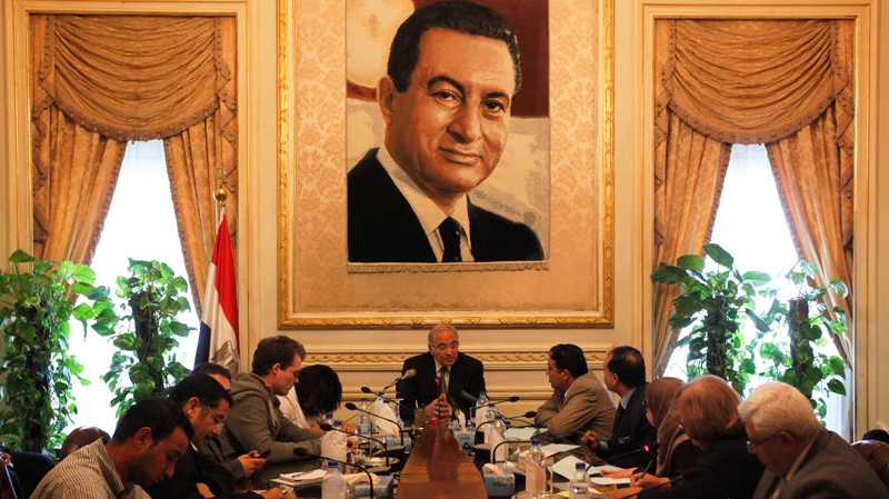 Egypt's recently appointed Prime Minister Ahmed Shafiq, centre, speaks to the media at the Ministry of the Interior in Cairo, Egypt, Thursday Feb.3, 2011.(AP / Victoria Hazou)