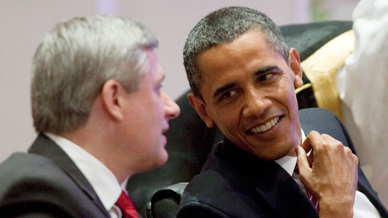 Canadian Prime Minister Stephen Harper speaks with United States President Barack Obama at the start of a working dinner at the G20 Summit in Toronto, Ont., on June 26, 2010. (Adrian Wyld / THE CANADIAN PRESS)