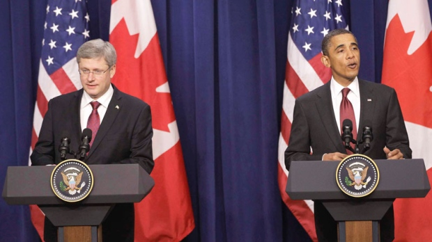 U.S. President Barack Obama and Prime Minister Stephen Harper take part in a joint news conference in the Eisenhower Executive Office Building, after their meeting at the White House in Washington, Friday, Feb. 4, 2011. (AP / Charles Dharapak)