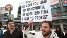 Demonstrators gather for a 'Stop The Internet Meter' rally to protest usage-based internet billing in downtown Toronto Friday, Feb. 4, 2011. (Darren Calabrese / THE CANADIAN PRESS)