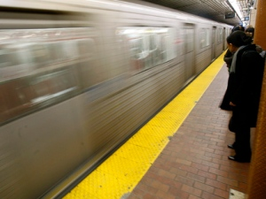 Commuters wait on a Toronto subway platform. (THE CANADIAN PRESS/J.P. Moczulski)
