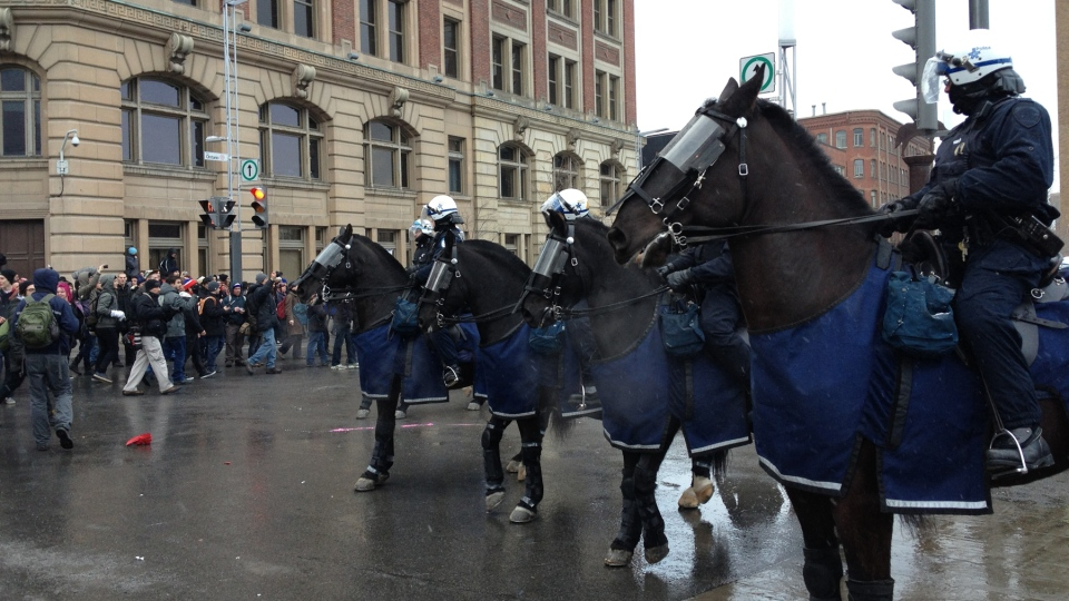 Montreal police cavalry during the Anti-Police Brutality Protest on Friday, March 15. (Kevin Gallagher / CTV Montreal)