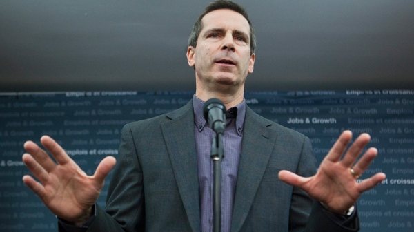 Ontario Premier Dalton McGuinty gestures as he speaks to members of the media in Ottawa on Friday, Feb. 4, 2011. The Ontario Liberal Party is holding its 2011 Platform Provincial Council meeting in Ottawa. (Pawel Dwulit / THE CANADIAN PRESS)