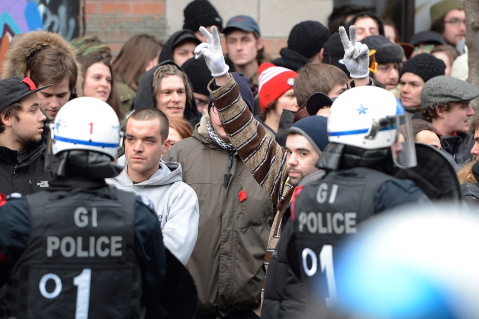 People participate in an anti-police brutality demonstration in Montreal on Friday March 15, 2013. Police used horses, pepper-spray and kettling tactics to clamp down Friday on an annual protest that has a history of getting rowdy.THE CANADIAN PRESS/Ryan Remiorz