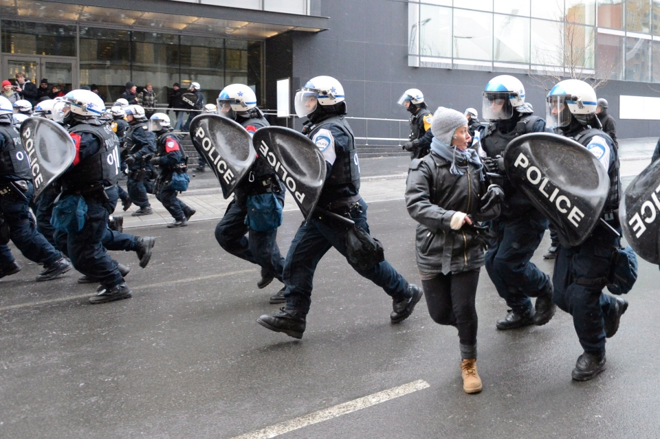 Riot police charge during an anti-police brutality demonstration in Montreal on Friday March 15, 2013. (Ryan Remiorz / THE CANADIAN PRESS)