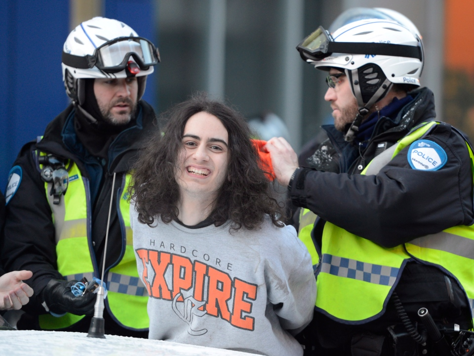 A protestor is arrested during an anti-police brutality demonstration in Montreal on Friday March 15, 2013. (Ryan Remiorz / THE CANADIAN PRESS)