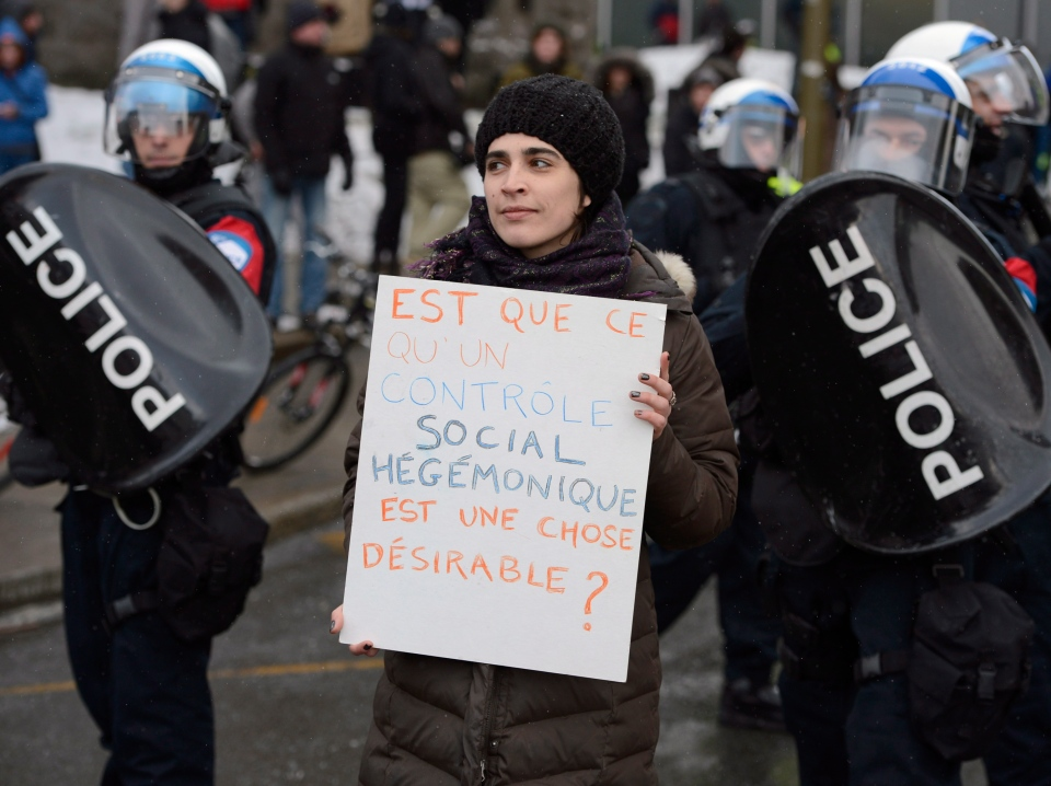 People participate in an anti-police brutality demonstration in Montreal on Friday March 15, 2013. (Ryan Remiorz / THE CANADIAN PRESS)