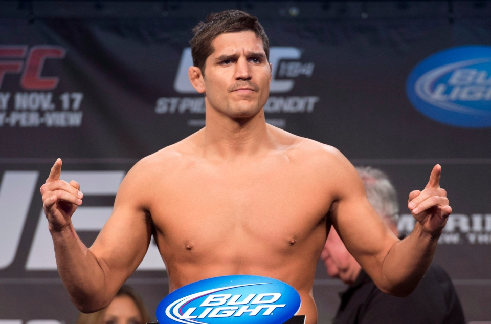 Mixed-martial arts fighter Patrick Cote stands on a scale during a weigh-in in advance of UFC 154 in Montreal on Friday, Nov. 16, 2012. (The Canadian Press/Paul Chiasson)