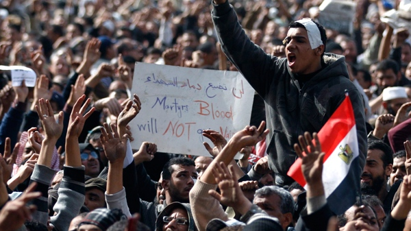 Anti-government protesters react in Tahrir Square, Cairo, Egypt, Friday, Feb. 4, 2011. (AP / Khalil Hamra)