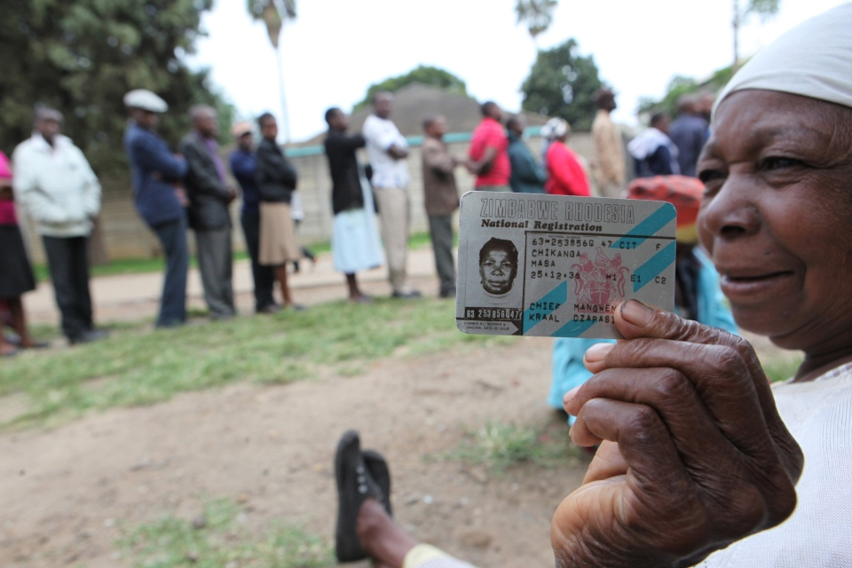 An elderly woman shows her identity card while waiting to cast her vote during a referendum in Harare, Zimbabwe, Saturday, March, 16, 2013. (AP / Tsvangirayi Mukwazhi)