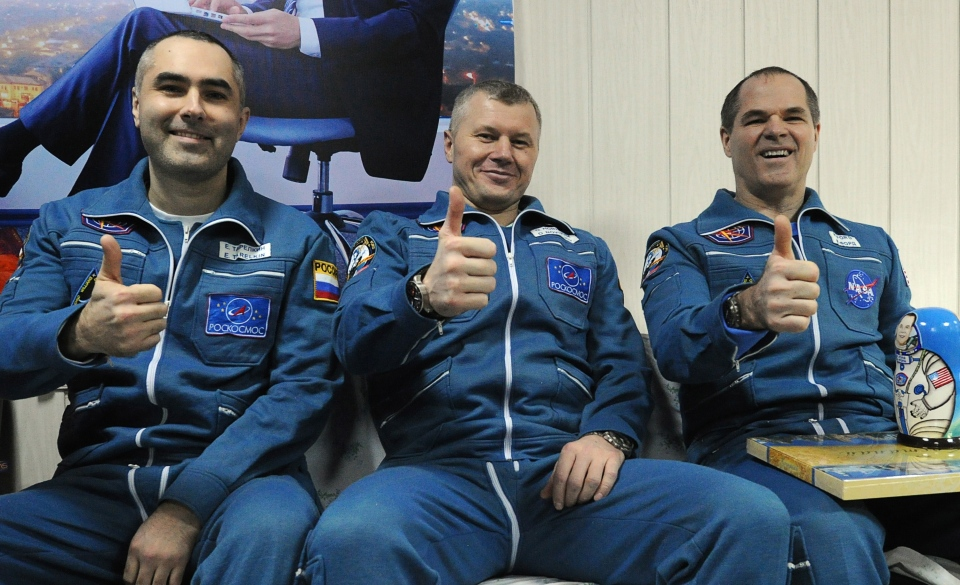 Russian cosmonauts Yevgeny Tarelkin, left, Oleg Novitsky, center, and NASA's astronaut Kevin Ford pose for a photo at the airport of the Kazakh city of Kostanai after their landing in northern Kazakhstan, Saturday, March 16, 2013. (AP / Alexander Nemenov)