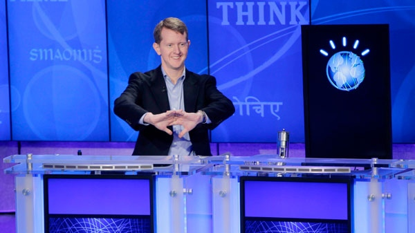 'Jeopardy!' contestant Ken Jennings, who won a record 74 consecutive games, cracks his knuckles before starting a practice match against another 'Jeopardy!' champion and an IBM computer called 'Watson' in Yorktown Heights, N.Y., Thursday, Jan. 13, 2011. (AP Photo / Seth Wenig)