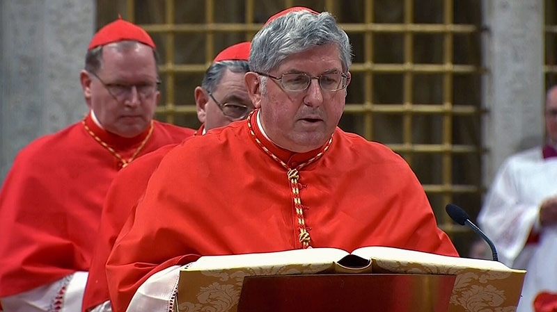 Cardinal Thomas Collins takes an oath of secrecy inside the Sistine Chapel at the Vatican, Tuesday, March 12, 2013.
