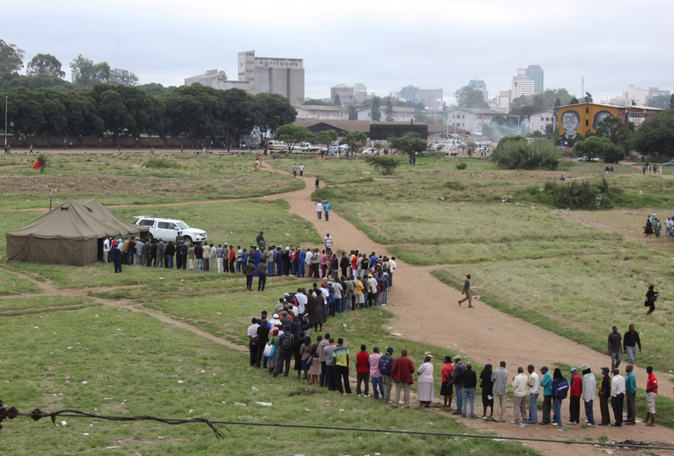Zimbabweans wait in a line to cast their votes during a referendum in Harare, Zimbabwe, Saturday, March, 16, 2013. (AP / Tsvangirayi Mukwazhi)