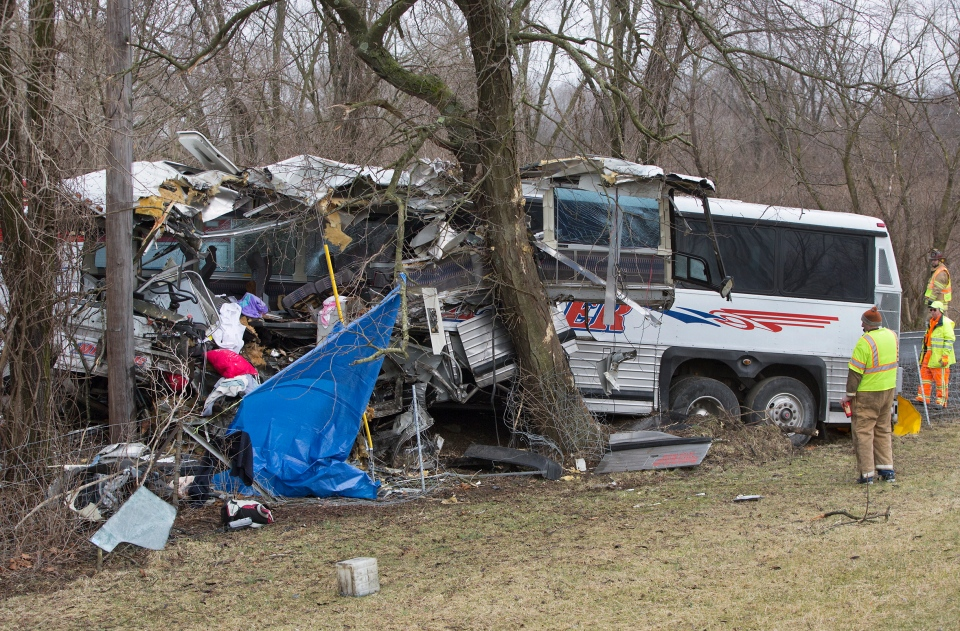Authorities investigate a passenger bus crash on the Pennsylvania Turnpike near Carlisle, Pa., on Saturday, March 16, 2013. (The Patriot-News / Joe Hermitt)