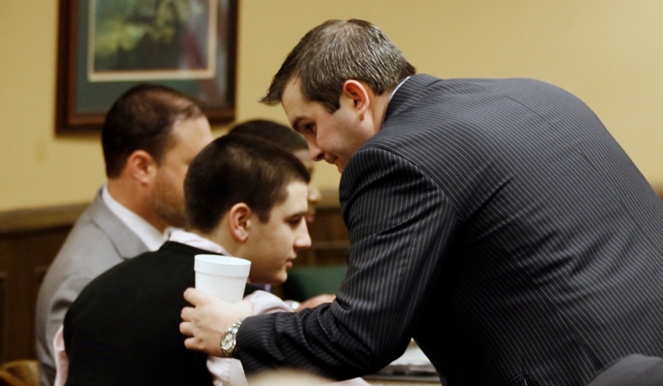Trent Mays, 17, left, talks with one of his defense lawyers, Brian Duncan, before the start of the fourth day of his and co-defendant 16-year-old Ma'lik Richmond's trial on rape charges in juvenile court in Steubenville, Ohio on Saturday, March 16, 2013. (AP / Keith Srakocic)