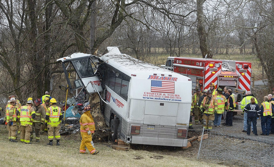 Emergency and rescue crews respond to the scene of a tour bus crash on the Pennsylvania Turnpike near Carlisle, Pa., on Saturday, March 16, 2013. (The Sentinel / Jason Malmont )