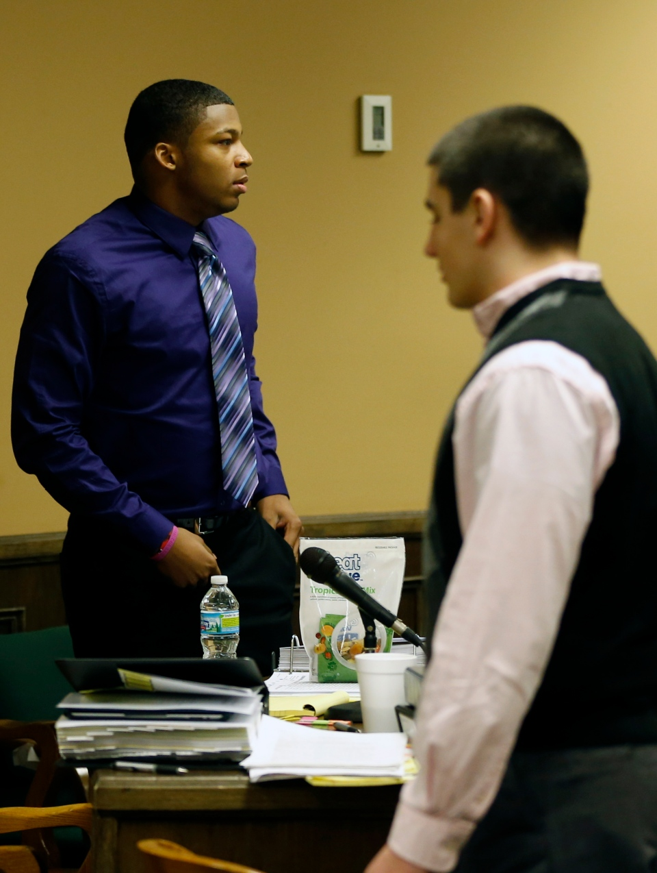 Ma'lik Richmond, 16, left, and co-defendant Trent Mays, 17, right, walks around in the court room during a break on the fourth day of the juvenile trial for he and co-defendant on rape charges in juvenile court in Steubenville, Ohio on Saturday, March 16, 2013.  (AP / Keith Srakocic)