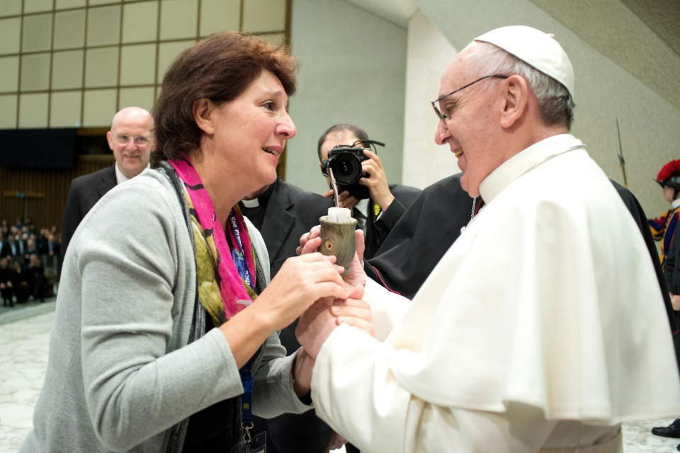 "Pope Francis receives a gift, a cup to drink the traditional South American beverage ""mate"", during a special gathering for thousands of journalists, media workers and guests the at the Vatican on Saturday, March 16, 2013.  (AP / L'Osservatore Romano, ho)"